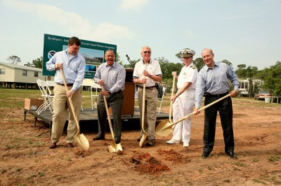 Government Officials, DISL Representatives, and NOAA Officials break ground on the new research facility
