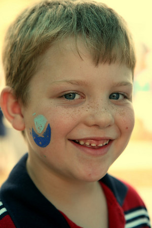 A participant in Discovery Day gets a NOAA logo painted on his face
