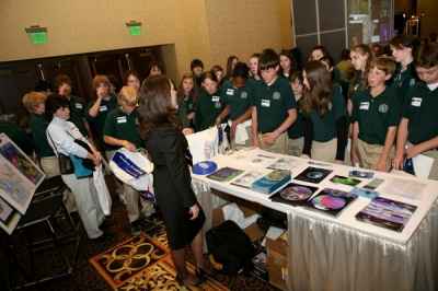 A Local School Group Gathers at the NOAA Booth to Hear Karrie Carnes Speak About the NOAA 200th Celebration